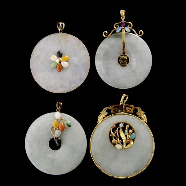 22: FOUR CARVED JADE DISK MULTI-STONE PENDANTS