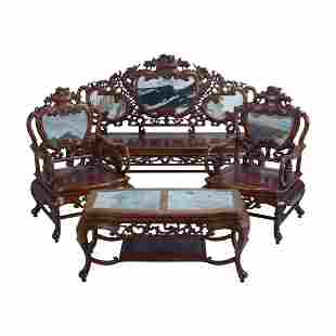 A Chinese Eight-Piece Rosewood Couch Set.