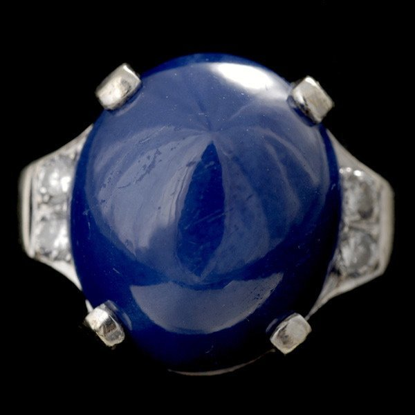 10: SYNTHETIC STAR SAPPHIRE, 14K WHITE GOLD RING.