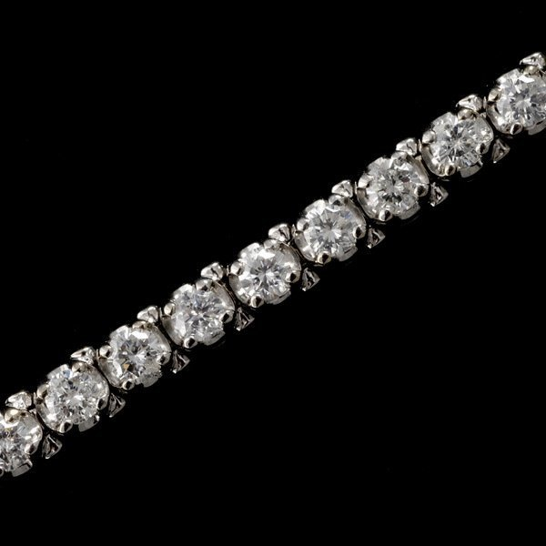 17: DIAMOND, 14K WHITE GOLD BRACELET.