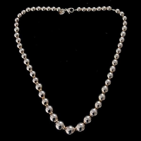 8: TIFFANY & CO. STERLING SILVER BEAD NECKLACE.