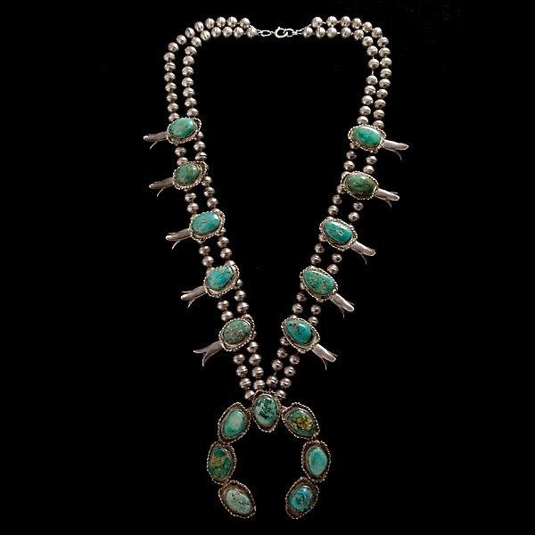 11: NAVAJO TURQUOISE, SILVER SQUASH BLOSSOM NECKLACE.