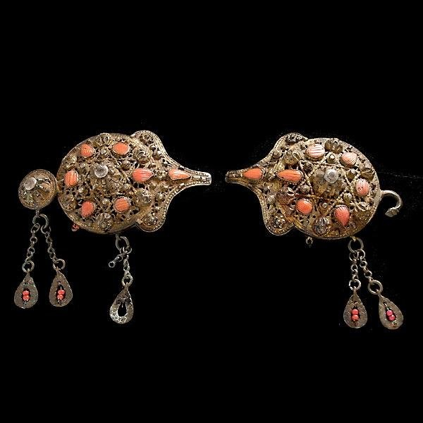 12: PAIR OF TRIBAL CORAL, SILVER GILT BUCKLES.