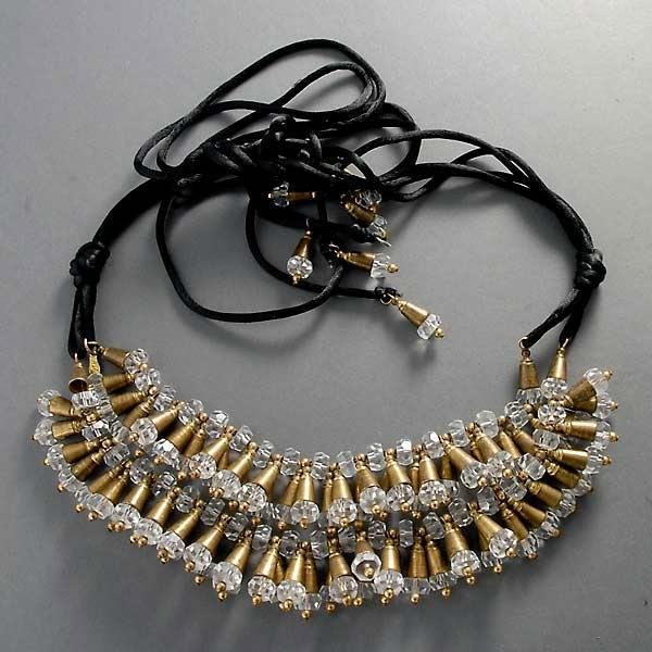 22: LEAD CRYSTAL, BRONZE, SILK CORD NECKLACE.