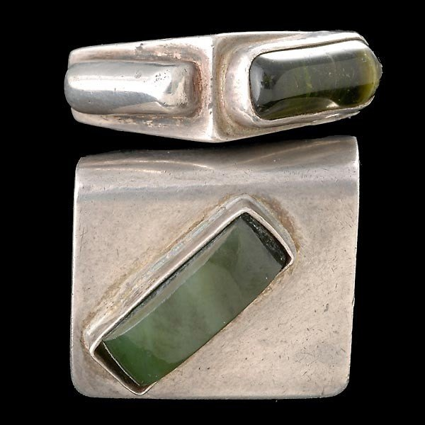 7: TWO MODERNIST STERLING RINGS WITH GREEN STONES.