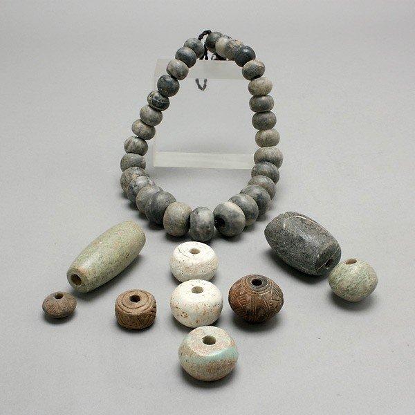 1008: one strand and nine pre-columbian ceramic beads