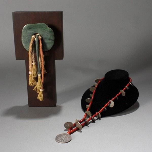 1009: two items: bead necklace and ancient maya ear fla