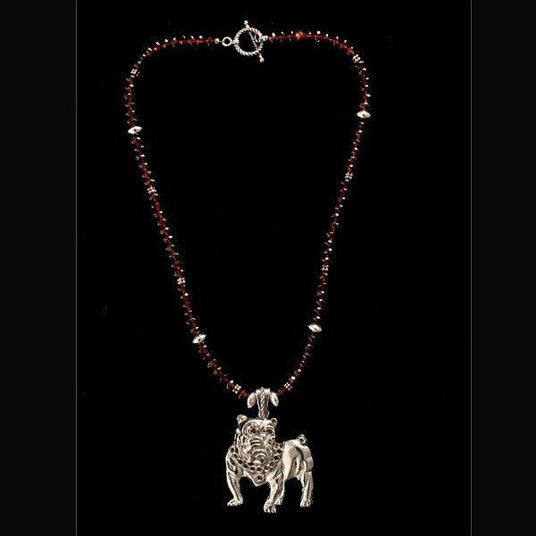 11: GARNET, STERLING SILVER, METAL DOG NECKLACE.