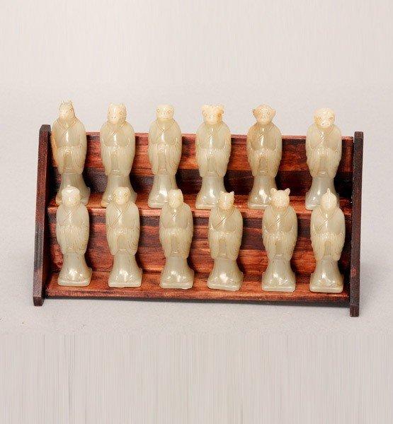 8011: A Set of Twelve Carved White Jade Zodiac Figures