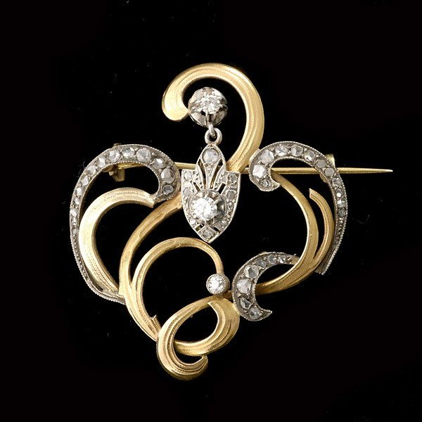 85: DIAMOND, SILVER TOPPED, 14K YELLOW GOLD BROOCH.