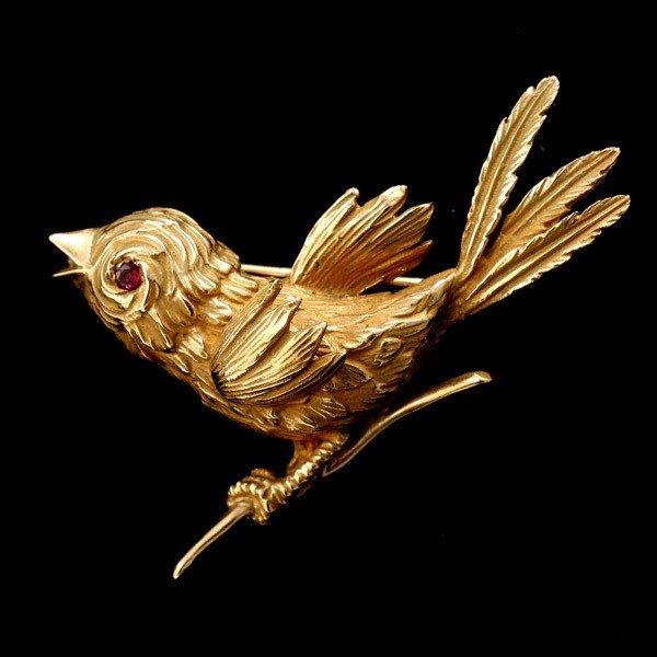 87: RUBY, 14K YELLOW GOLD BIRD BROOCH.