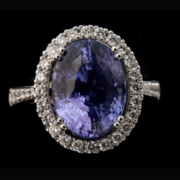 194: TANZANITE, DIAMOND, 18K WHITE GOLD RING.