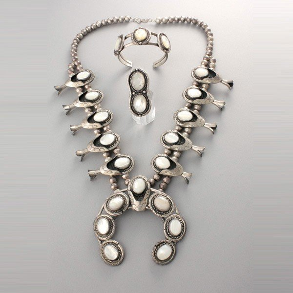 11: SUITE OF MOTHER-OF-PEARL, SILVER JEWELRY.