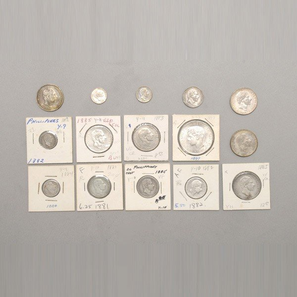 1158: Fifteen Philippine 19th Century Silver Coins.