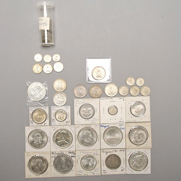 1168: Collection of fifty-seven Philippine Silver Coins