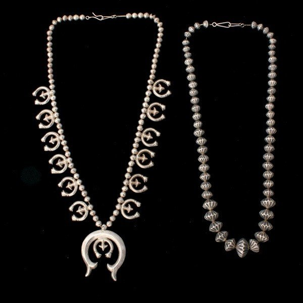 18: COLLECTION OF TWO SILVER NECKLACES.