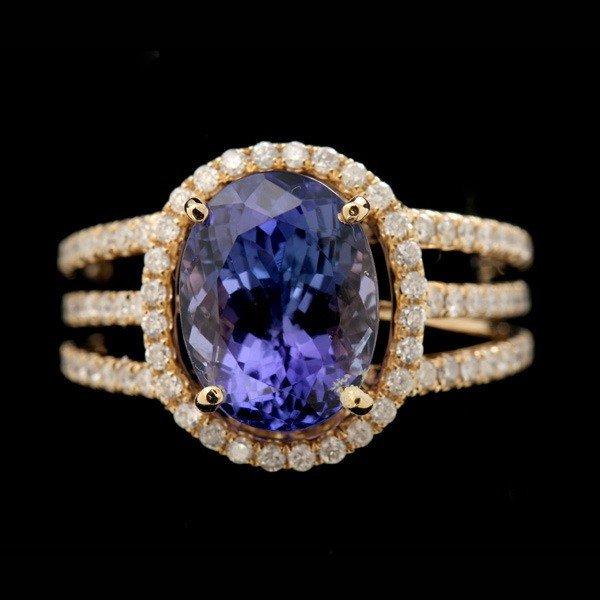 72: TANZANITE, DIAMOND, 14K YELLOW GOLD RING.