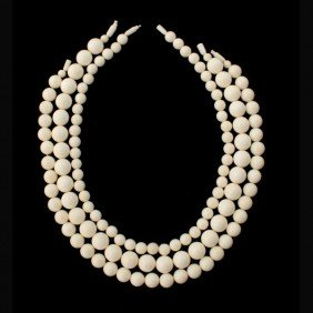 1: COLLECTION OF THREE STRANDS OF CARVED IVORY BEADS.