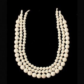 3: COLLECTION OF THREE STRANDS OF CARVED IVORY BEADS.