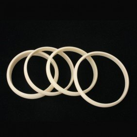 6: COLLECTION OF FOUR CARVED IVORY BANGLES.