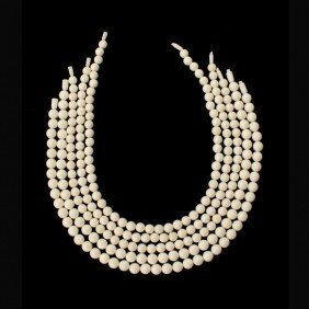 COLLECTION OF FIVE STRANDS OF IVORY BEADS.