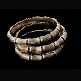 10: COLLECTION OF THREE STERLING SILVER BRACELETS.