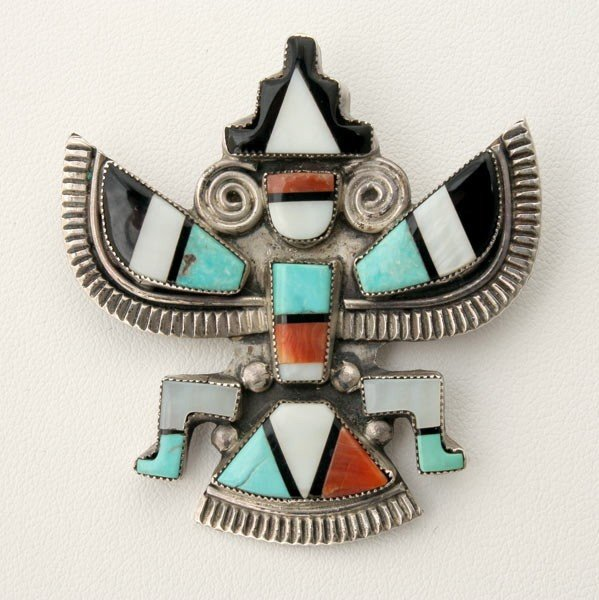 18: ZUNI, SILVER, MULTI-STONE KNIFEWING MAN BROOCH.