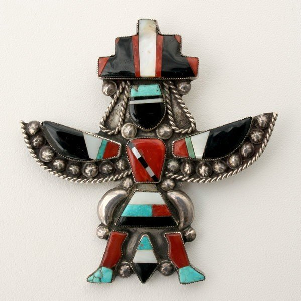 20: ZUNI SILVER, MULTI-STONE, KNIFEWING MAN BROOCH.