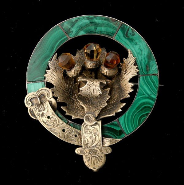 23: MALACHITE, GLASS THISTLE SILVER-GILT BROOCH.
