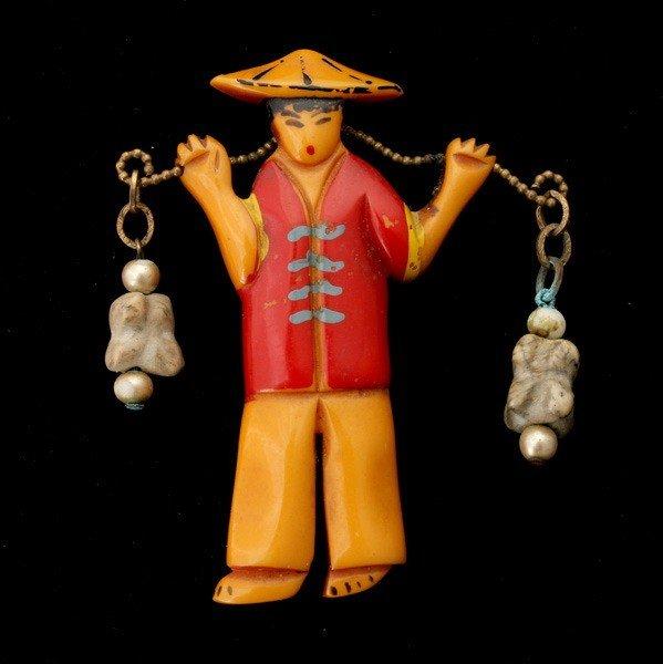 18: BAKELITE HAND PAINTED ASIAN FEMALE BROOCH.