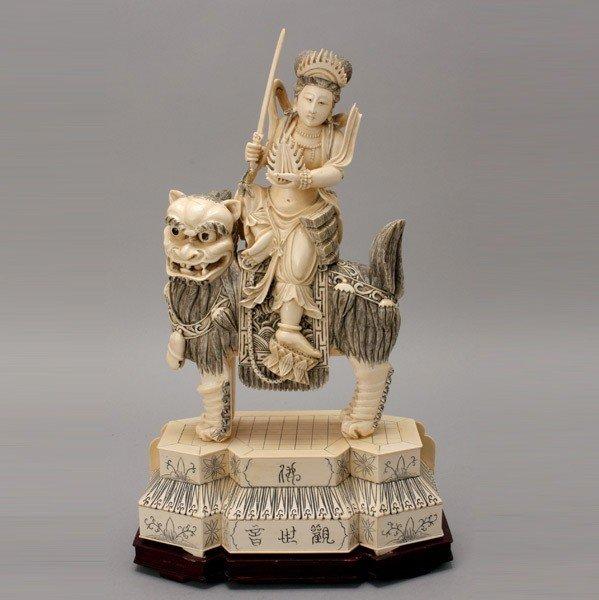 6001: A Carved Ivory Figure Riding a Beast*