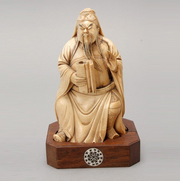 6007: A Carved Ivory Seated Figure*