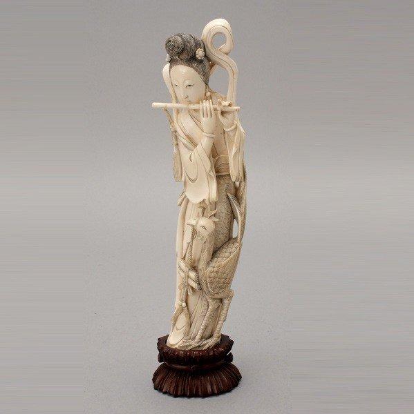 6008: An Ivory Female Figure*