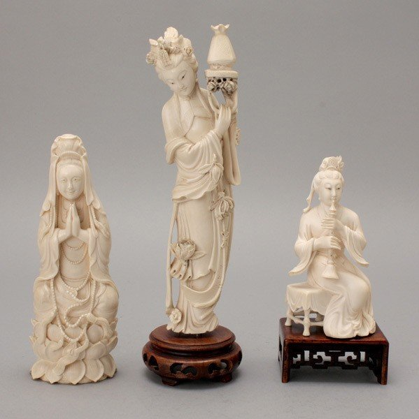 6009: A Group of Three Figural Ivory Carvings*