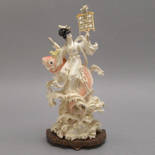 6014: A Painted Ivory Female Celestial Figure*