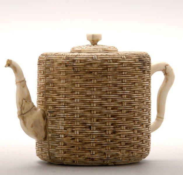 6019: A Small Ivory Teapot*