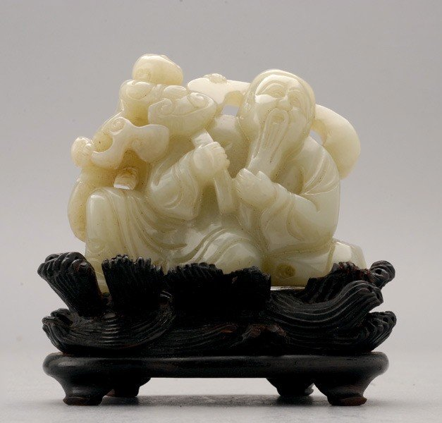 6057: A Jade Carving of a Figural Group