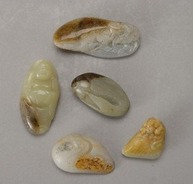 Five Small Carved Jade Toggles