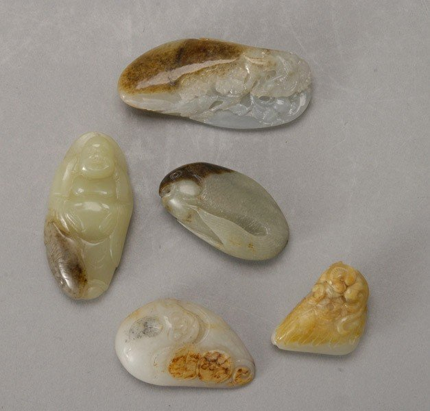 6062: Five Small Carved Jade Toggles