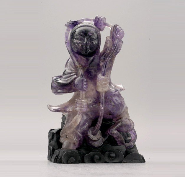 6098: An Amethyst Figural Carving