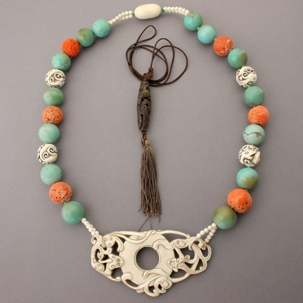2: COLLECTION OF TWO ASIAN MOTIF NECKLACES.