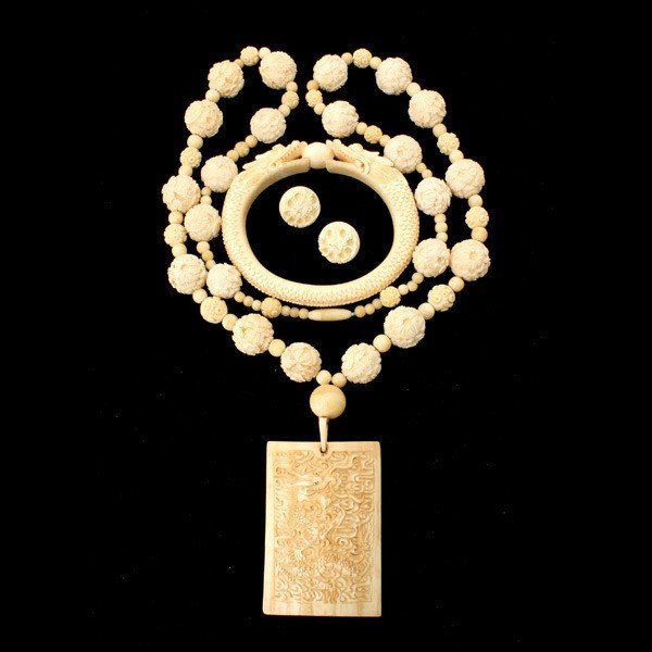 3: COLLECTION OF IVORY AND BONE JEWELRY.