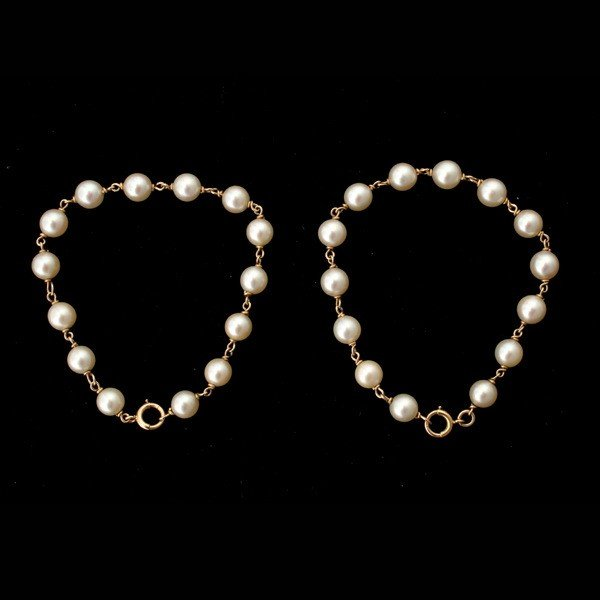 21: 2 CULTURED PEARL, 14K YELLOW GOLD BRACELETS.