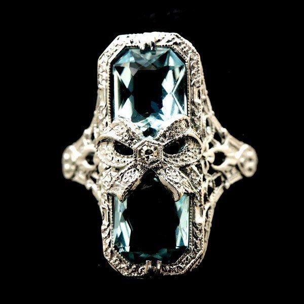 21: AQUAMARINE, DIAMOND, 14K WHITE GOLD RING.