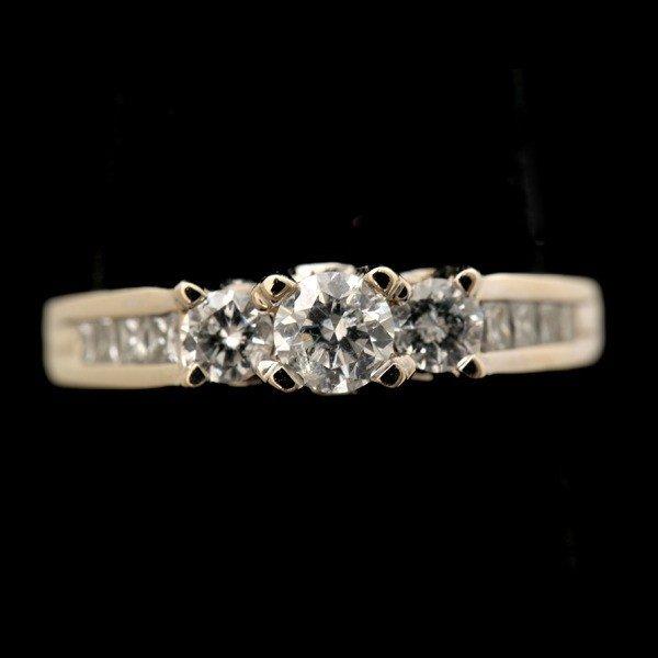 24: DIAMOND, 14K WHITE GOLD RING.