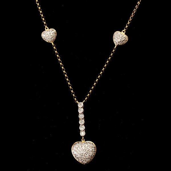 73: DIAMOND, 14K GOLD HEART NECKLACE.