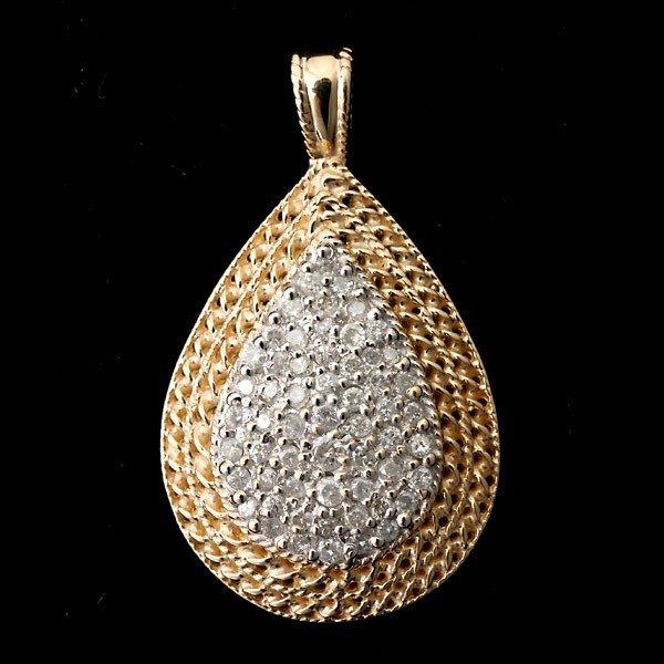 74: DIAMOND, 14K YELLOW GOLD PENDANT.