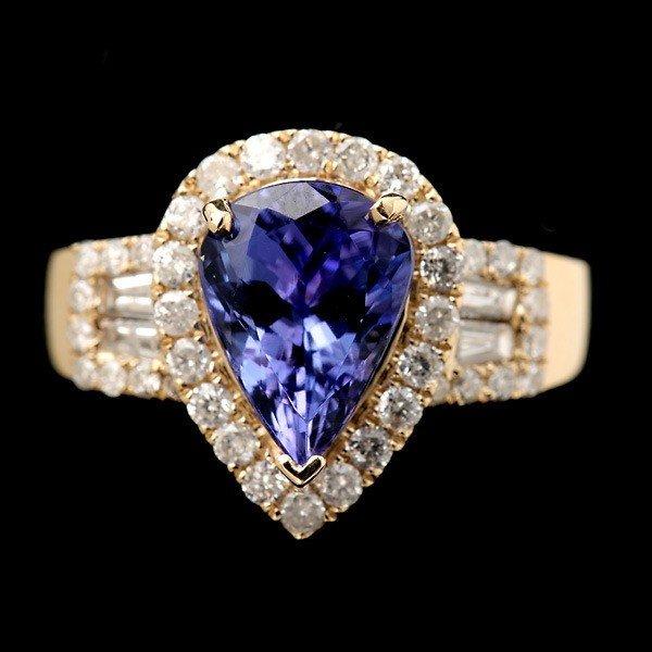 76: TANZANITE, DIAMOND, 14K YELLOW GOLD RING.