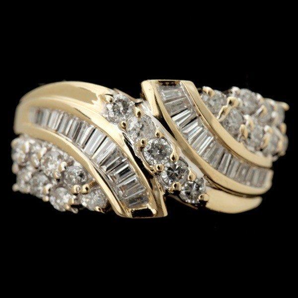 79: DIAMOND, 14K YELLOW GOLD RING.