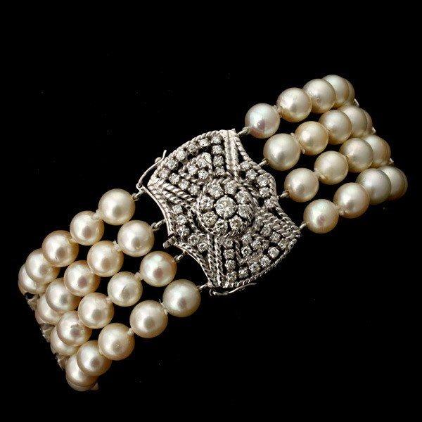 190: CULTURED PEARL, DIAMOND, 14K WHITE GOLD BRACELET.